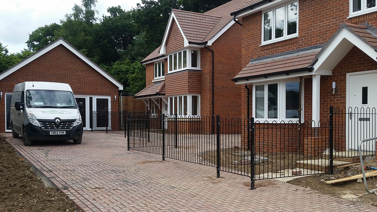 Metal railing installation for new home developments