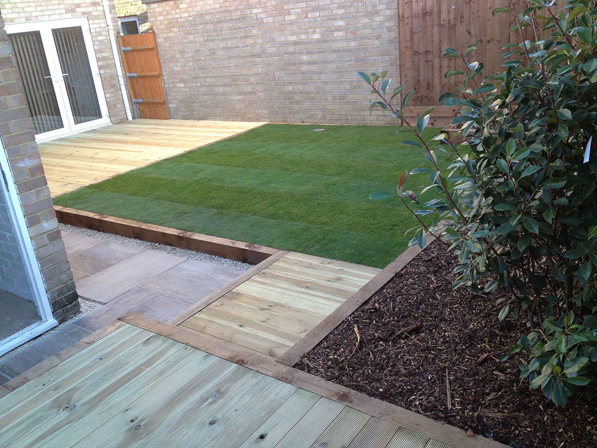 Wooden decking as part of a rear landscaped garden